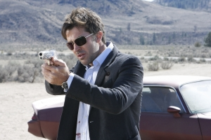 """Detective John Sheppard takes aim in season five's """"Vegas."""" Photo by Eike Schroter and copyright The Sci Fi Channel"""