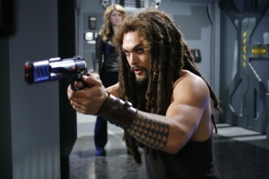 """""""Go ahead, make my day!"""" Ronon sets his sights on yet another bad guy in the season five episode """"The Lost Tribe."""" Photo by Eike Schroter and copyright The Sci Fi Channel"""