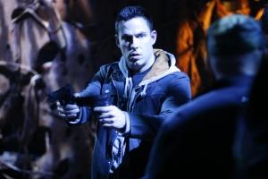 "Stargate Atlantis stunt coordinator James ""Bam Bam"" Bamford takes aim on the show's Vancouver, B.C. set. Photo courtesy of and copyright of MGM Studios"
