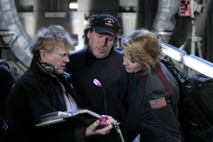 "Mikita confers with Amanda Tapping (Colonel Samantha Carter) on the set of ""Search and Rescue."" Photo by Eile Schroter and copyright of the Sci Fi Channel"
