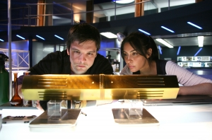 "Connor (Andrew-Lee Potts) and Sarah Page (Laila Rouass) try to decipher the meaning behind the mysterious ""artifact."" Photo copyright of Impossible Pictures"