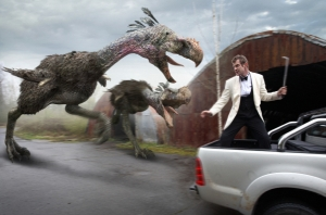 Danny Quinn (Jason Flemyng) tries to fight off the unwanted advances of a pair of Phorusrhacids. Photo copyright of Impossible Pictures