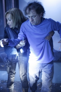 """Teyla gives Dr. Zelenka (David Nykl) a helping hand in season five's """"First Contact."""" Photo by Eike Schroter and copyright of the Sci Fi Channel"""
