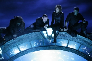 "Ronon (Jason Momoa), Dr. McKay (David Hewlett), Teyla and Colonel Sheppard (Joe Flanigan) end up trapped atop of a nearly submerged Stargate in ""The Shrine."" Photo by Eike Schroter and copyright of the Sci Fi Channel"