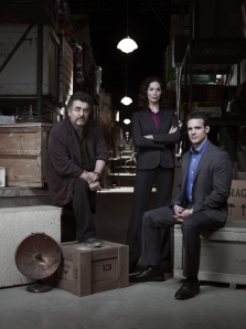 Saul Rubinek as Artie Nelsen, Joanne Kelly as Myka Bering and Eddie McClintock as Pete Lattimer in Warehouse 13. Photo by Justin Stephens and copyright of The Sci Fi Channel
