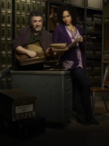 Saul Rubinek as Artie Nelsen and Genelle Williams as Leena in Warehouse 13. Photo by Justin Stephens and copyright of The Sci Fi Channel