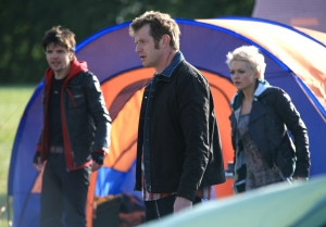 Danny (Jason Flemyng, center) arrives on the scene to lend Connor (Andrew Lee-Potts) and Abby (Hannah Spearritt) a hand. Photo copyright of Impossible Pictures