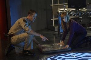 "Carter and Dr. Tess Fontana (Jamie Ray Newman) try to save the day in the season three episode ""Insane in the P-Brane."" Photo by Marcel Williams and copyright of the Syfy Channel"