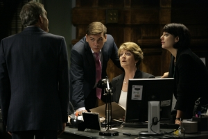 Government civil servant Bridget Hastings (Susan Brown, center) tries to make sense out of the chaos unfolding around her. Photo courtesy of and copyright of the BBC