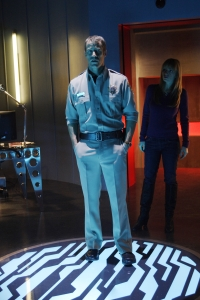 """Sheriff Carter and Dr. Tess Fontana (Jaime Ray Newman) end up slightly out of sync in """"Insane in the P-Brane."""" Photo by Marcell Williams and copyright of The Syfy Channel"""