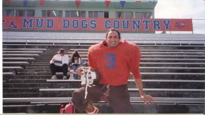 Papajohn stunt doubling for Adam Sandler in Waterboy. Photo courtesy of Papajohn's official website