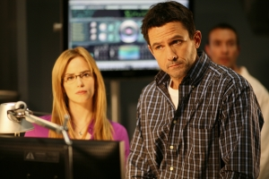 "Jamie Rae Newman as Dr. Tess Fontana and Billy Campbell as Dr. Bruce Manius in the Eureka episode ""Shower the People."" Photo copyright of The Syfy Channel"