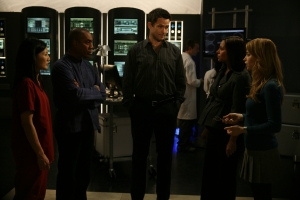 Kim Anderson (Tamlyn Tomita), Henry Deacon (Joe Morton), Dr. Manius, Dr. Allison Blake (Salli Richardson-Whitfield) and Tess Fontana try to unwravel the mystery surrounding drowned scientists. Photo copyright of The Syfy Channel