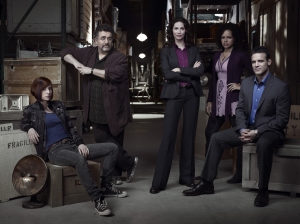 The cast of Warehouse 13 (L-R): Allison Scagliotti (Claudia Donovan), Saul Rubenik (Artie Nielsen), Joanne Kelly (Myka Bering), Genelle Williams (Leena) and Eddie McClintock (Pete Lattimer). Photo copyright of The Syfy Channel