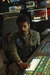 Evram monitors a situation while on-duty on the Antares flight deck. Photo by Sergei Bachlakov and copyright of Fox Studios and ABC