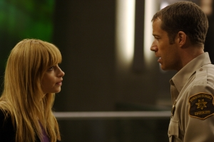 "Dr. Tess Fontana (Jaime Ray Newman) and Sheriff Jack Carter (Colin Ferguson) have an unconventional introduction to one another in the Eureka episode ""Insane In The P-Brane."" Photo by Marcel Williams and copyright of The Syfy Channel"