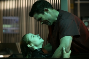 "Tess is helped through a life-and-death situation by an old friend, Dr. Bruce Manius (Billy Campbell), in ""Shower the People."" Photo copyright of The Syfy Channel"