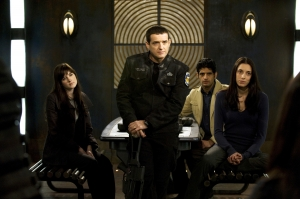 "Colonel Everett Young (Louis Ferreira, second from left) and Sergeant Vanessa James (Julia Anderson) in ""Darkness."" Photo by Carole Segal and copyright of The Syfy Channel"