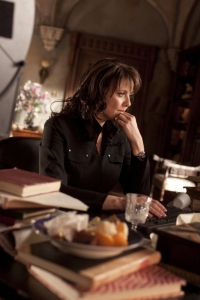 "Dr. Helen Magnus (Amanda Tapping) tries to make sense of recent events in ""Eulogy."" Photo by Jeff Weddell and copyright of The Syfy Channel"