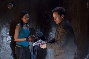 "Kate (Agam Darshi) and Henry (Ryan Robbins) find themselves in a sticky situation in ""Eulogy."" Photo by Jeff Weddell and coporight of The Syfy Channel"