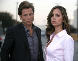 "Jamie Bamber and Eliza Dushku (Echo) in the seasn two Dollhouse premiere ""Vows."" Photo copyright of Fox Television"
